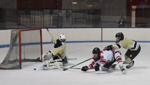 Clarkstown goalie Jason Inzeo redirects a shot from