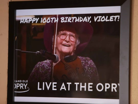 Violet Hensley turned 100-years-old on Oct. 21, 2016. Her birthday was celebrated at Silver Dollar City where she has displayed her fiddle making craft for 50 years. The newest photo in her booth was taken when she recently played at the Grand Ole Opry.