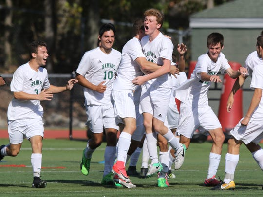 Ramapo celebrates their game winning goal scored by Liam Nelson late in the game.