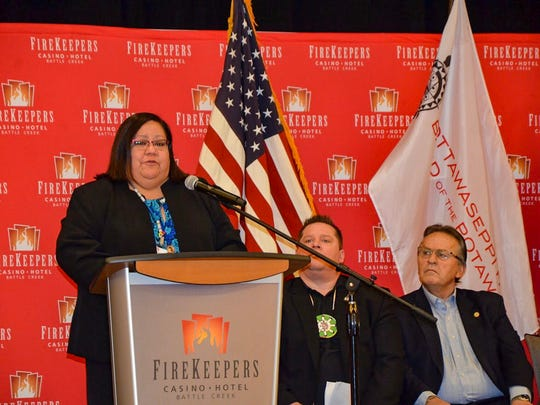 FireKeepers Casino Hotel CEO Kathy George speaks to a gathered audience about some of the casino's accomplishments in 2017 before the checks are presented to the state and the FireKeepers Local Revenue Sharing Board.
