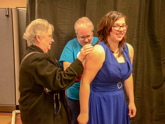 On-the-spot alterations are part of the services Charitable Union is offering at its free prom dress event.