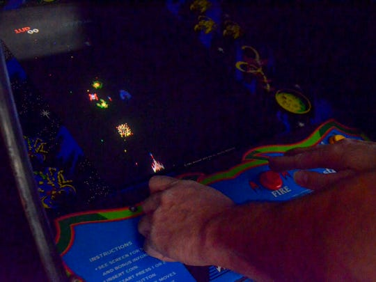 Battle Creek resident Jon Klinkel holds a world record in Galaga on the rapid fire setting.