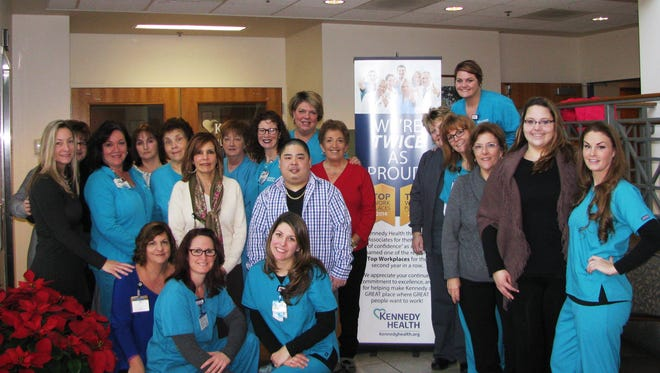 A group of 31 Kennedy health radiology department workers hit Wednesday's Powerball for $50,000.