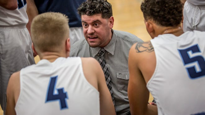 Richmond coach Josh Presnell talks with players on the bench during a basketball game Tuesday, Feb. 7, 2017 at Richmond High School.