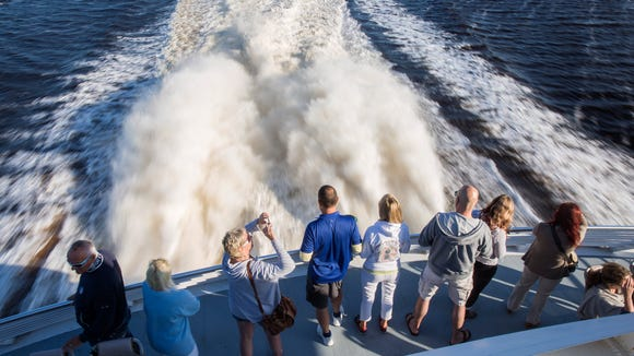 Passengers take in the view aboard the Key West Express as it takes off from the Matanzas Harbor in Fort Myers Beach early on Monday morning, Nov. 20, 2017. The ferry service offers daily trips to and from Key West, about 3 hours each way, making for an easy and leisurely weekend or day-trip.