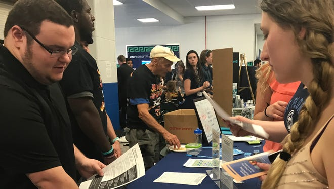 Volunteer Adam Smith explains the dangers of human trafficking and modern sex slavery to students at the University of West Florida's Take Back the Night event on April 6, 2017.