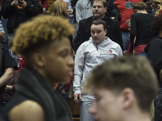 IU coach Archie Miller watches as New Albany's Romeo Langford, left, shakes hands with Bloomington South players.