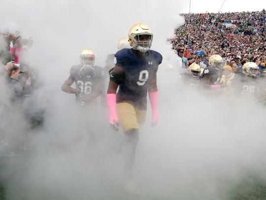 Fighting Irish defensive lineman Daelin Hayes (9) will be counted on to provide an improved pass rush this fall.