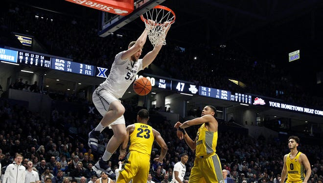 Xavier Musketeers forward Sean O'Mara (54) dunks in the second half during the NCAA basketball game between the Marquette Golden Eagles and the Xavier Musketeers,  Wednesday, Jan. 24, 2018, at Cintas Center in Cincinnati. Xavier won 89-70.