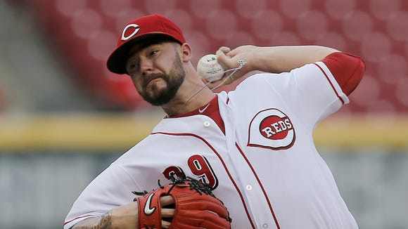 Cincinnati Reds starting pitcher Brandon Finnegan (29) delivers a pitch in the top of the first inning of the MLB National League game between the Cincinnati Reds and the Miami Marlins at Great American Ball Park in downtown Cincinnati on Monday, Aug. 15, 2016. After four innings the Marlins led 2-1.