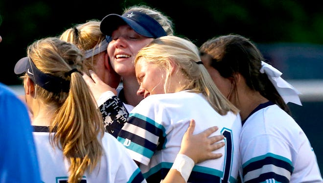 Siegel players (L to R) Sam Whitwell (35), Madison Levi (22), Kristin Lee (25) and Lauren Lee (1) comfort earch other after losing to Lincoln County in the 4-AAA softball semifinal on Monday, May 14, 2018, at Siegel.