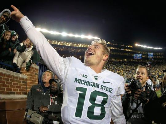 Michigan State quarterback Connor Cook celebrates a