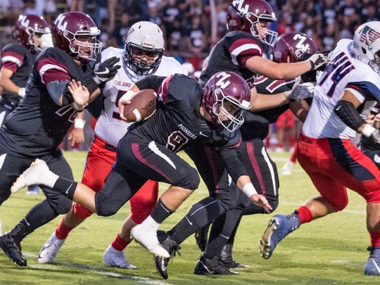 Mt. Whitney's Nick Magana runs against Tulare Western