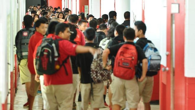 In this Sept. 12, 2013, file photo, students exit classrooms at Agueda Johnston Middle School.