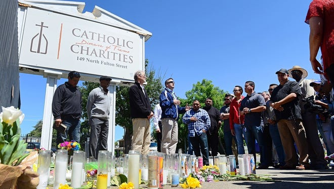Pastors and church leaders from the Pastor Clusters of the Fresno/Clovis area meet outside Catholic Charities in Fresno during a prayer walk vigil April 20 for the three victims of the Fresno rampage.