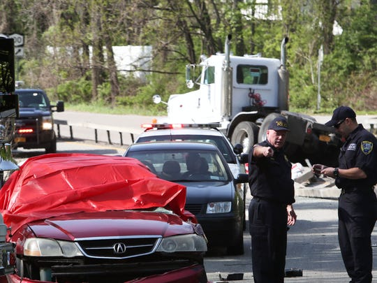 Briarcliff Manor police and firefighters along with Westchseter County police investigate the scene of an accident on Route 9A just north of Pleasantville Road in Briacliff May 13, 2014.