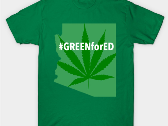 Michael Comunale, an entertainer known for his stoner alter ego HotRock SupaJoint, created the #GreenForEd  T-shirt. He is not affiliated with #RedForEd.