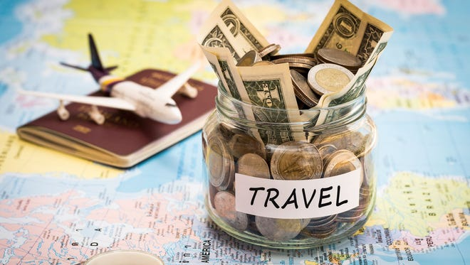 When traveling abroad, you need to figure out the best way to make purchases during your trip.
