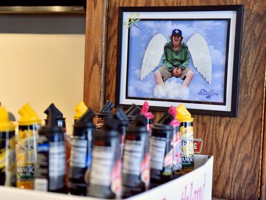 An artistic rendering of Skyler Montgomery hangs near the bar at Dead Lightning Still Works in New Cumberland.
