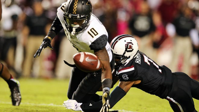 Vanderbilt wide receiver Trent Sherfield (10) loses the ball as South Carolina cornerback Al Harris Jr. (7) breaks up the pass during the second half on Oct. 17, 2015.