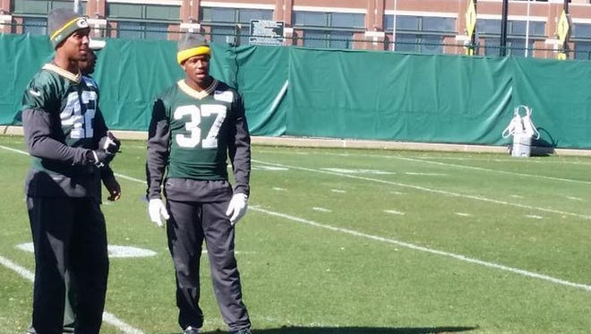 Green Bay Packers safety Morgan Burnettt (42) and cornerback Sam Shields (37) went through stretching and warmups, then watched Tuesday's practice at Clarke Hinkle Field.