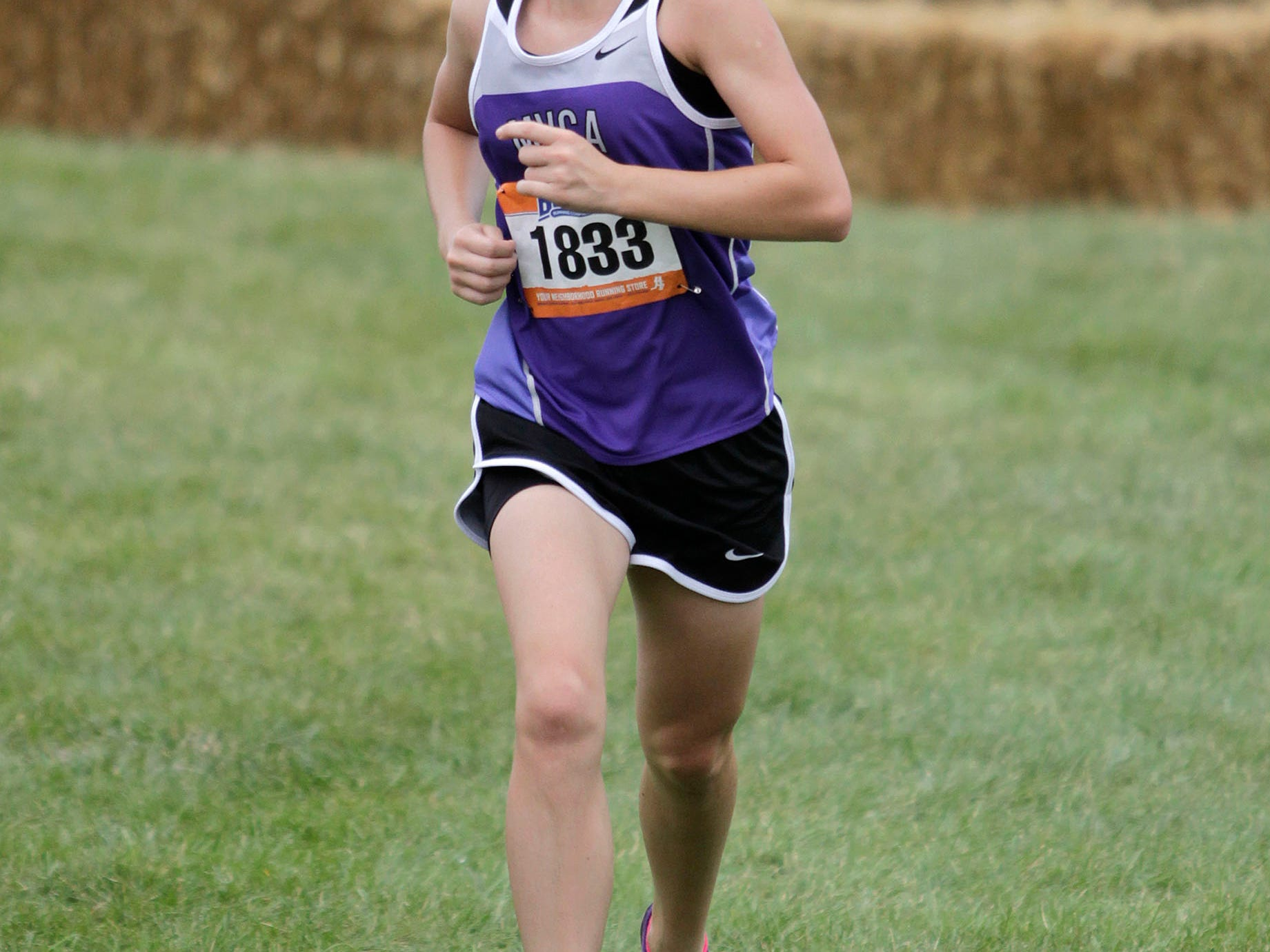 Laura Vilardo of MVCA hits the home stretch at the Mason High School Invitational in September. She will run for the Lions this spring.