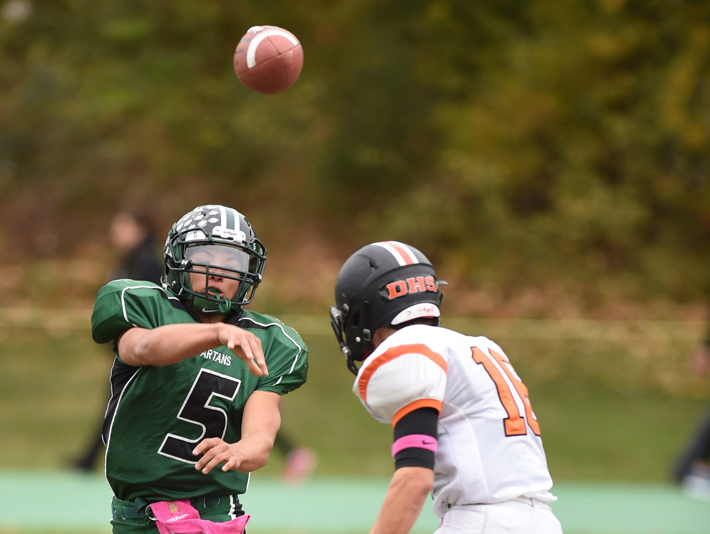 Spackenkill's Camron Abalos pass the ball as Dover's Russell Bradshaw closes in on him during Saturday's game in Poughkeepsie.