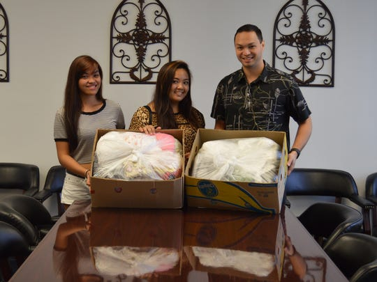 Jamie De Leon and Claire Pascua dropped off Typhoon Soudelor relief donations at Sen. Michael San Nicolas' office Tuesday.