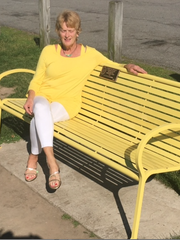 Maureen McGlynn sits on the bench in Cobbs Hill park