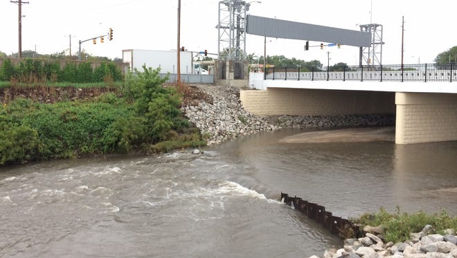 Walnut Creek rising with rainfall Tuesday afternoon.