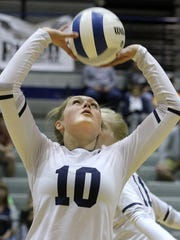 Piedra Vista's Kamryn Gordon sets the ball against Cleveland on Saturday at the Jerry A. Conner Fieldhouse.