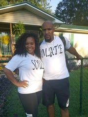 "Rosetta Hughley and Demario Hughley wearing matching ""soulmate"" shirts."