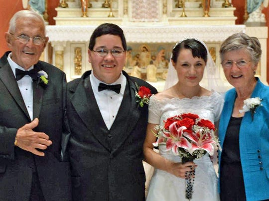 Ernie Mitchell of Ave Maria with his wife, Mary and newlyweds Tony Thomas and Rebekah Angstman after Ernie served as best man at their wedding.