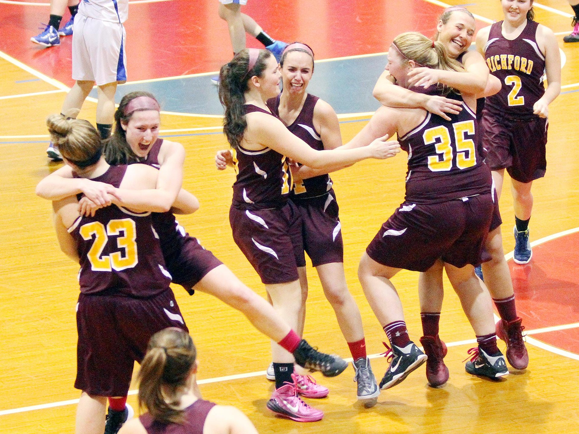 The Richford Rockets celebrate following their 71-36 win over Thetford in the Division III high school girls basketball state championship game in March.