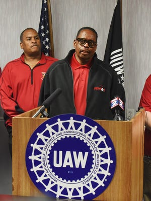 United Auto Workers chief Ford negotiator, Jimmy Settles, right, speaks, during a Nov. 18, 2015, news conference on the proposed 2015 UAW-Ford contract in Dearborn, Mich.