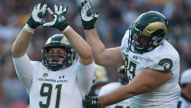 CSU defensive lineman Jakob Buys celebrates after a play during the Rocky Mountain Showdown at Sports Authority Field at Mile High in Denver on Friday, September 1, 2017.