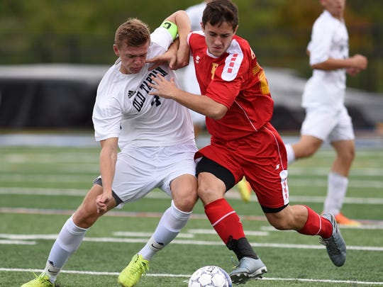 Old Tappan's Colin Eifert #4 and Bergen Catholic's Brian Salcedo #23 struggle for a loose ball. Eifert received a yellow card on the play. Bergen Catholic played Old Tappan in the quarterfinals of the 2017 B.C.C.A. tournament in Mahwah on Sunday, October 15, 2017.