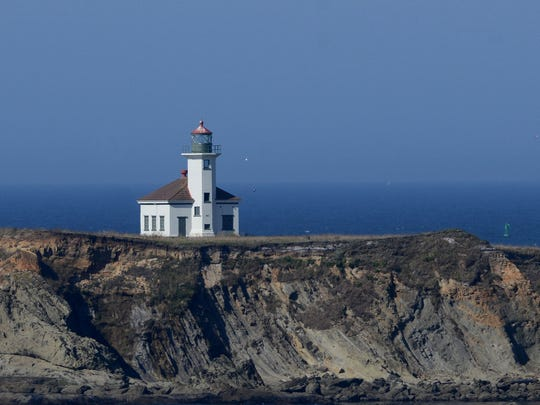 Cape Arago Lighthouse, as seen from a viewpoint near Sunset Bay State Park, just north of Shore Acres State Park near Coos Bay. Photographed on Wednesday, Aug. 20, 2014.