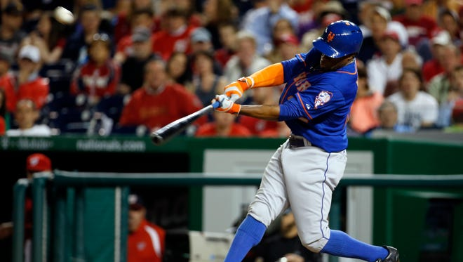 New York Mets' Eric Young Jr. hits an RBI double during the fifth inning of a baseball game against the Washington Nationals at Nationals Park Friday, May 16, 2014, in Washington.