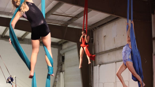 Team members work out on the silks at Extreme Air Sports in Estero.