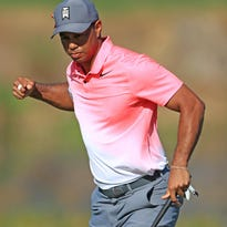 Friday's golf: Woods 4 back at Honda Classic