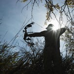 Bow Hunter Aiming Compound Bow