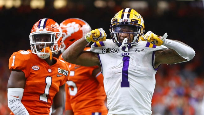 LSU wide receiver Ja'Marr Chase wore No. 1 last year but will don the school's coveted No. 7 this season. Chase is already being projected to be the first wideout taken in next year's NFL draft. He led the Tigers last year with 84 catches and 20 touchdowns.