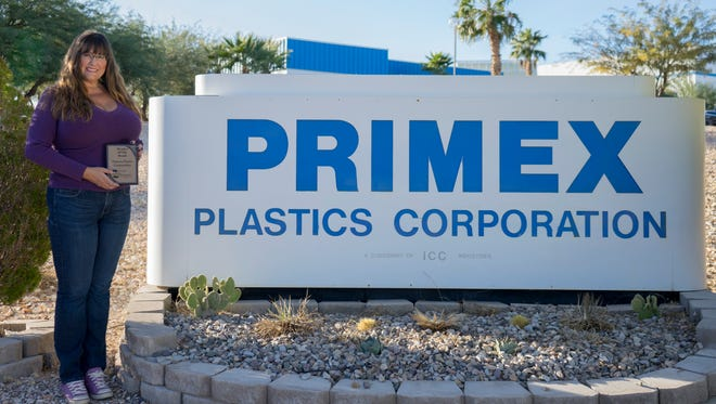 Primex Plastics manager and human resources director Kim Woolsey holds 2017 Mesquite Business of the Year award