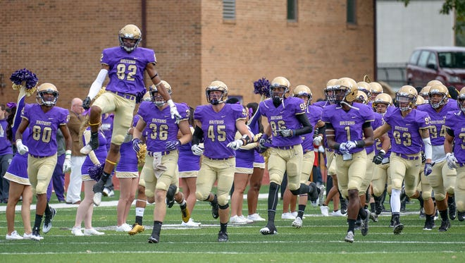 The Albion College football team takes the field on Oct. 15, 2016.