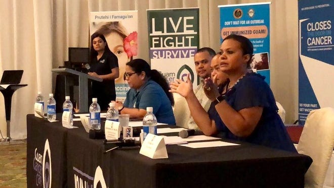Guam Department of Education Chief Nurse Julietta Quinene, right, gestures as she talks about the launching of a school-based immunization program focused on cancer prevention and HPV vaccine, during a press conference Tuesday Jan. 16, 2018, in Tumon.