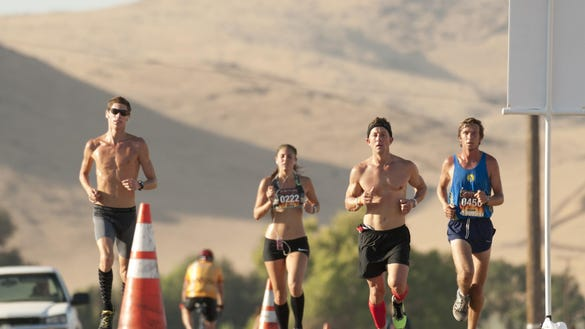 Runners pass the 9-mile mark just before the last climb