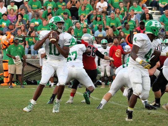 Bolivar's Trey Lowe drops back to pass against Adamsville