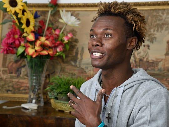 Haitian immigrant Jean Radyn Piard in the living room