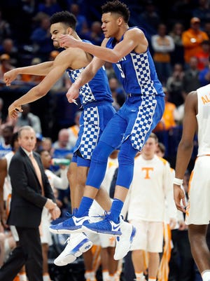 Kentucky's Sacha Killeya-Jones, left, celebrates with Kevin Knox (5) during the second half of an NCAA college basketball championship game against Tennessee at the Southeastern Conference tournament.